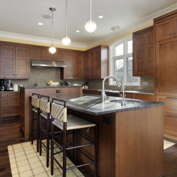 Kitchen,In,Luxury,Home,With,Oak,Wood,Cabinetry